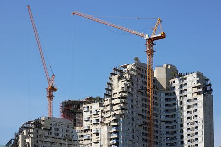 Tower Cranes Working on a High Rise Building under Construction 스톡 콘텐츠 - 149199678