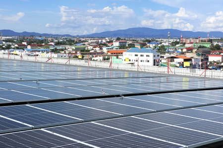 Solar PV System on Industry Roof with City Background