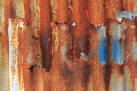 corrugated steel: Background texture of rusty zinc sheet used on the exterior wall or roof of a building Stock Photo