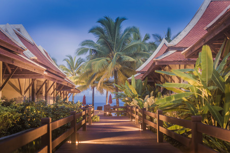 Pathway through villas to the tropical beach in HDR photo
