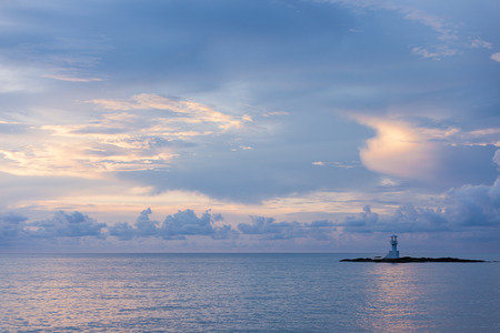 Lighthouse on the coast of Khao Lak Thailand after the sunset photo