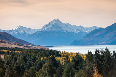 Mount Cook towering over glacial Lake Pukaki in hues of turquoise. photo