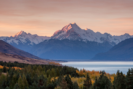 aoraki mount cook national park: Mount Cook towering over glacial Lake Pukaki in hues of turquoise during the sunset