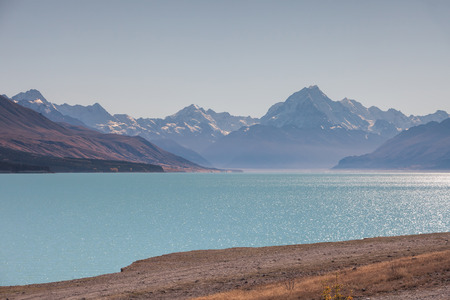 Turquoise lake near Twizle town, New Zealand, with Mt. Cook  in the back ground photo