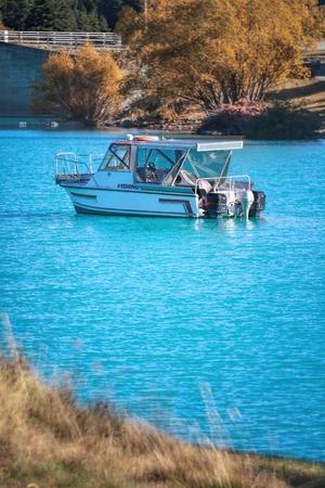 turqoise: Fishing boat in a turqoise lake, Tekapo, New Zealand