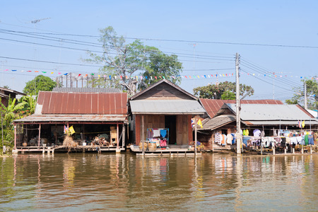 distric: Typical house of the origin community along side of a canel in Amphawa distric, Thailand