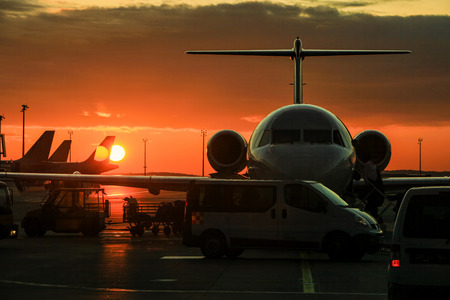 air: Security van at Vienna airport with private jet and aircrafts in the background