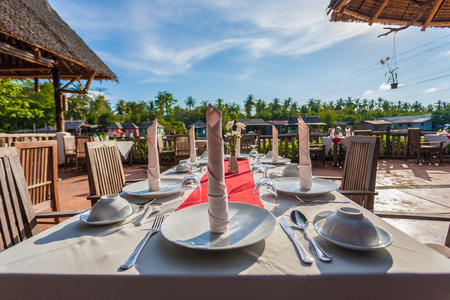 Dining tables setup in a restaurant photo