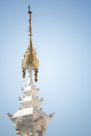 Ornament on top of stupa in buddhism temple, Nan province, Thailand photo