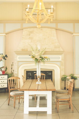 Wooden dinnertable with vintage decoration in pastel color photo