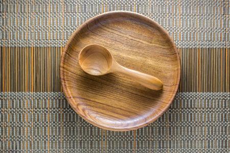 Dinning utensil set up on a green weaved bamboo mat