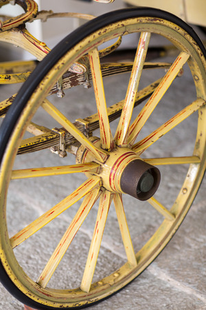 wooden wheel and spring of an antique wooden wagon Stock Photo