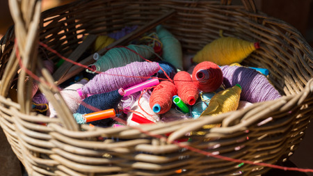 weave ball: Colorful thread balls in a rattan basket