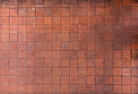 Background of orange clay floor tiles in square shape with grungy texture and looks Stock Photo