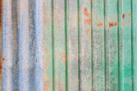 metal pattern: Background texture of rusty zinc sheet used on the exterior wall or roof of a building Stock Photo