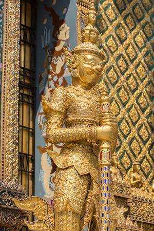 in wat phra kaew: Ornate famous giant at Wat Phra Kaew, Grand Palace, Bangkok, Thailand with temple roof in the background.