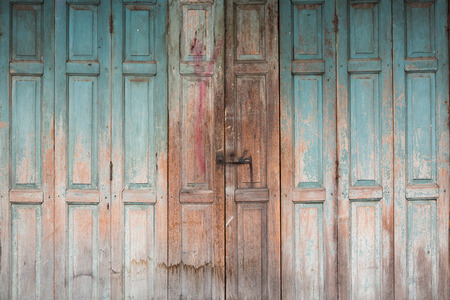 colour in: Folding wooden door frame with stained color in countryside.
