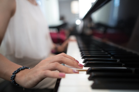 vintage look: Lady playing piano with vintage look Stock Photo