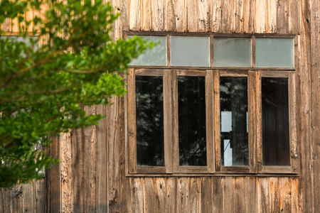 log wall: Window frame on wooden house in countryside of Thailand