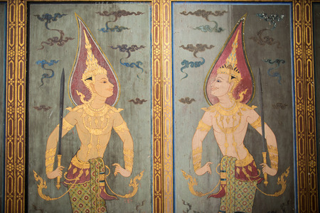 angles: Water color painting of guardian angles on wall in ancient temple in Bangkok, Thailand Editorial