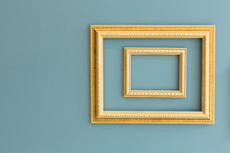the greenish: Golden classic picture frames isolated on greenish yellow wall.