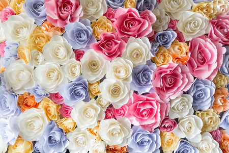 wedding backdrop: Backdrop of colorful paper roses background in a wedding reception.