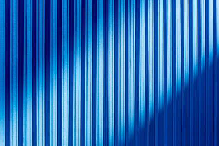 hilight: Background and texture of blue color corrugated metal sheet with shadow and hilight effect.