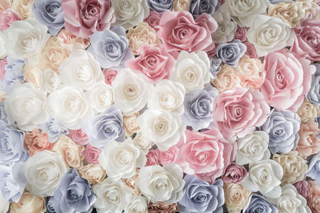 exhibitions: Backdrop of colorful paper roses background in a wedding reception with soft colors.