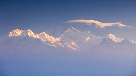 darjeeling: Kanchenjunga  range peak in early morning light with thick mist , Darjeeling, Sikkim, India Stock Photo