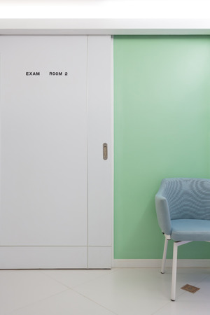 exam room: Waiting in front of an exam room inside a hospital. Stock Photo