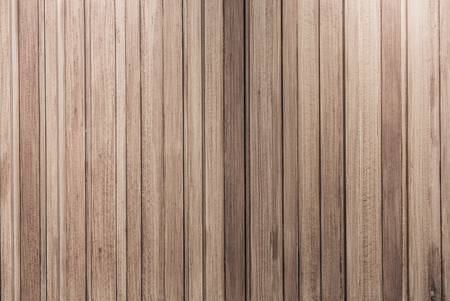 down lights: Wooden wall background and texture lit with down lights with grunge looks and pale color.