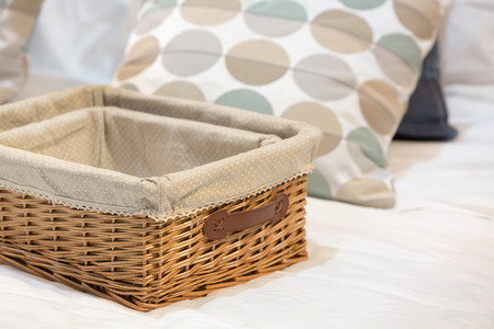 organize: Wicker baskets in different size on a white bed. Stock Photo