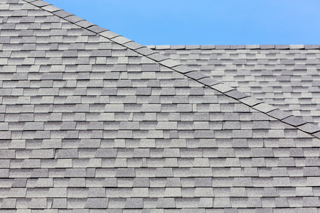 roofing: Close up of new rubber roof tiles with blue skybackground. Stock Photo