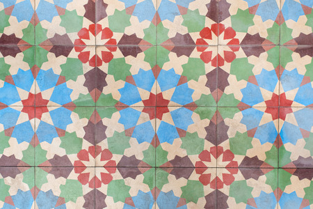 tiles floor: Ancient floor tiles with colorful flower pattern.
