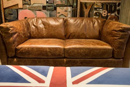 brown leather sofa: Vintage brown leather sofa with England flag tea table.