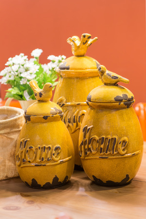 Yellow Decoration Jars On Top Of Dining Table And A Vase Of White