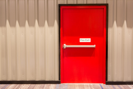 fire protection: Red fire exit door in an office building.