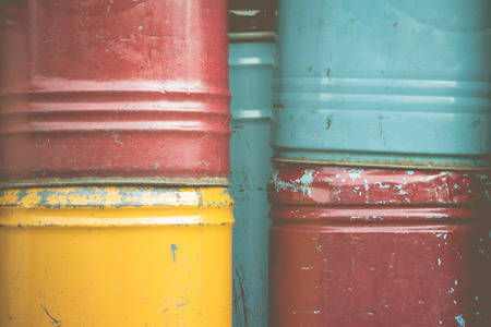 barrel bomb: Colorful stack of  rusty chemical barrels in vintage tone. Stock Photo