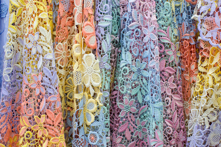 lace pattern: Display of Pile of colorful lace fabric.