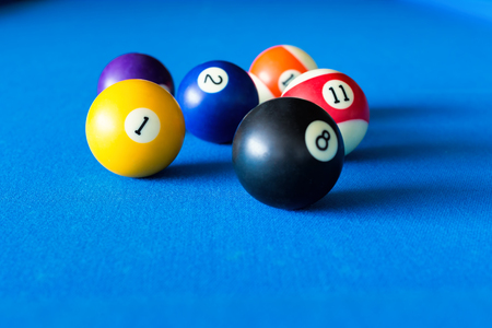 pool balls: Colorful pool balls on a blue table.
