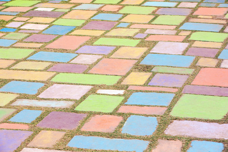 play ground: Background of colorful cement block play ground decorated in a garden with shallow depth of field. Stock Photo