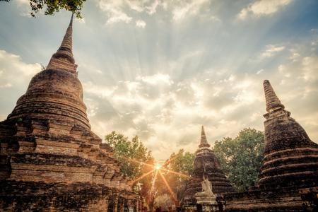 buildings city: Pagoda and buddha image of ruin city at Unesco,Sukhothai historical park , Sukhothai, Thailand in HDR.