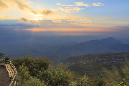 tortuous: Sunrise in cloudy morning with mountain view and blue sky and tortuous road in the distance. Phu Tubberk,  Phetchabun, Thailand. Stock Photo