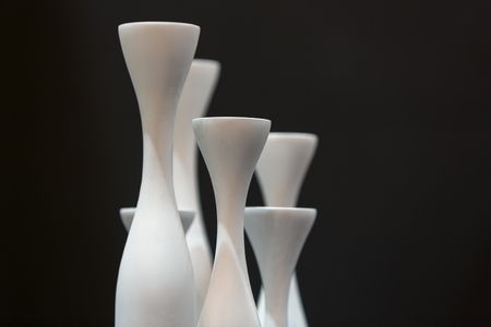 Abstract And Black And White Of Curves Of Empty Vases On A Dining