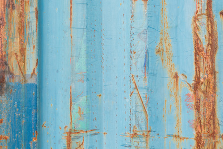 modern architecture: Background and texture of  old blue color corrugated metal sheet with rust and scratch.