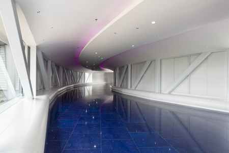 simulate: Interior of a white and blue modern pedestrian overpass  tunnel using led lights to simulate space travel.