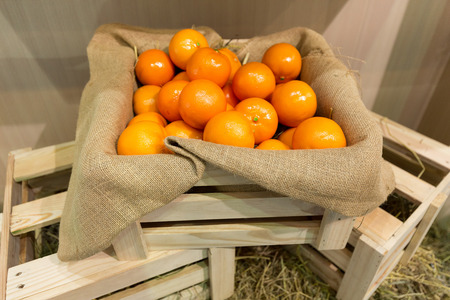 gunny: Fresh oranges in a wooden crate protected with gunny sack ready for shipping.