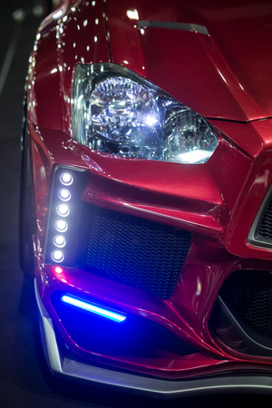front bumper: BANGKOK, THAILAND - JUNE 22 : Special front right head light and LED decoration lights attached to front bumper  spoiler  displayed in Bangkok International 2016 Auto Salon.