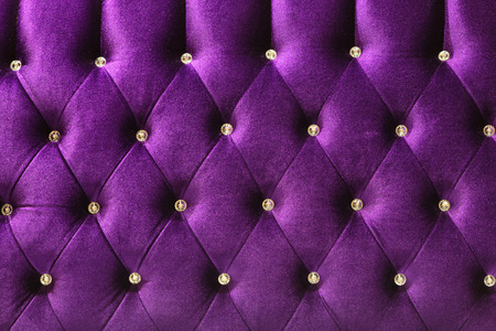 Background of purple Velvet  fabric modern sofa in close up. Stock Photo