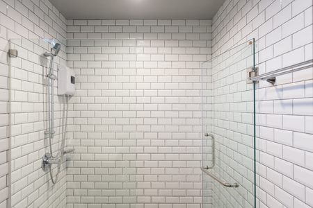 Big glass shower box in a clean white white room. Stock Photo